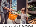 mom and daughter are shopping... | Shutterstock . vector #1134288341