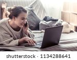 girl at home at computer ... | Shutterstock . vector #1134288641