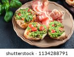 bruschetta with fresh pesto ... | Shutterstock . vector #1134288791