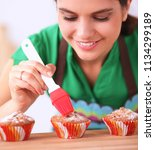 woman is making cakes in the... | Shutterstock . vector #1134299189