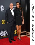 Small photo of LOS ANGELES, CA - July 14, 2018: Bruce Willis & Emma Heming at the Comedy Central Roast of Bruce Willis at the Hollywood Palladium