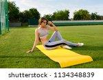 fitness girl on stadium  sporty ... | Shutterstock . vector #1134348839