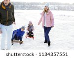 happy family with sledge... | Shutterstock . vector #1134357551