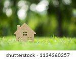 wood house model on grass field | Shutterstock . vector #1134360257