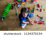 preschool child  playing with... | Shutterstock . vector #1134370154