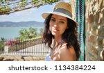 woman in summer dress walking... | Shutterstock . vector #1134384224