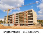 industrial tower cranes at... | Shutterstock . vector #1134388091
