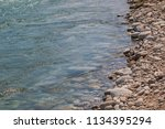 the stone edge of the river | Shutterstock . vector #1134395294