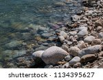 the stone edge of the river | Shutterstock . vector #1134395627