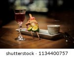 red summer cocktail and... | Shutterstock . vector #1134400757