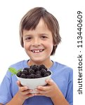 Happy boy with fresh blackberries in a bowl - healthy diet concept, isolated - stock photo