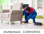 repair contractor repairing... | Shutterstock . vector #1134415421