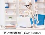 skeleton businessman working in ... | Shutterstock . vector #1134425807