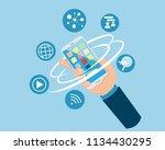 flat hand holding smartphone... | Shutterstock .eps vector #1134430295