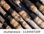 oil drill pipe. rusty drill... | Shutterstock . vector #1134447209