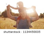 happy grandfather gives... | Shutterstock . vector #1134450035