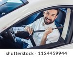 portrait of smiling man... | Shutterstock . vector #1134459944