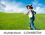 girl running in the meadow | Shutterstock . vector #1134480704
