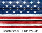 usa flag elements on wood... | Shutterstock . vector #1134493034