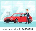 car salesman in dealer showroom.... | Shutterstock .eps vector #1134500234