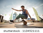 young active man keeping... | Shutterstock . vector #1134521111