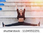 woman working out in an outdoor ...   Shutterstock . vector #1134552251