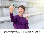 young woman with pixie hair...   Shutterstock . vector #1134552254