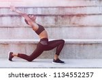 woman working out in an outdoor ...   Shutterstock . vector #1134552257