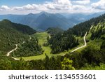 sunlit hiking trail in the... | Shutterstock . vector #1134553601