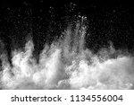 explosion of white dust on... | Shutterstock . vector #1134556004
