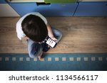 kid boy playing with smart... | Shutterstock . vector #1134566117