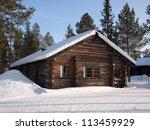 Romantic Snow Covered Log Cabi...