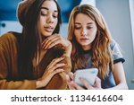 serious female friends reading... | Shutterstock . vector #1134616604