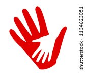 three hands on hands  charity...   Shutterstock .eps vector #1134623051