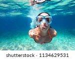 beautiful young woman diving... | Shutterstock . vector #1134629531