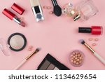 cosmetics and makeup brushes on ... | Shutterstock . vector #1134629654