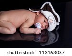 newborn baby boy with funny hat | Shutterstock . vector #113463037