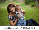 happy little boy in the park... | Shutterstock . vector #113464141