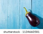 eggplant with shade on blue...   Shutterstock . vector #1134660581