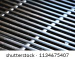 a recently cleaned grill at a... | Shutterstock . vector #1134675407