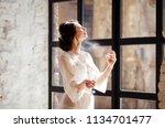 beautiful bride girl holding...   Shutterstock . vector #1134701477