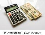 calculator with us dollars ... | Shutterstock . vector #1134704804