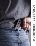 a man conceals a firearm in the ... | Shutterstock . vector #113470609