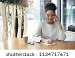 young african descent woman...   Shutterstock . vector #1134717671