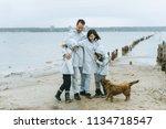family fun near the sea with a... | Shutterstock . vector #1134718547