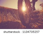 bicyclist riding up a mountain... | Shutterstock . vector #1134735257