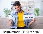 man frustrated at bills he...   Shutterstock . vector #1134755789