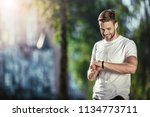 happy well shaped male standing ... | Shutterstock . vector #1134773711