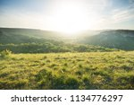 sunrise in mountains at summer... | Shutterstock . vector #1134776297