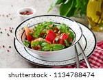 tomato salad with basil and... | Shutterstock . vector #1134788474
